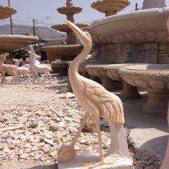 踩球仙鶴雕塑,晚霞紅動物石雕